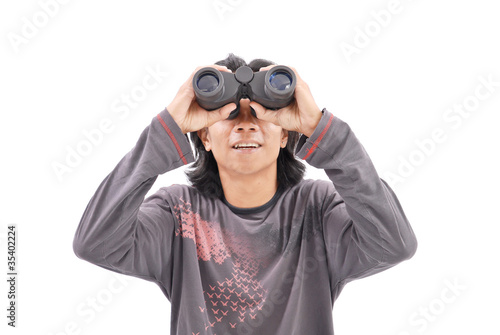 Guy Smiling While Looking Up with Binoculars