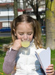 little girl drinking a juice