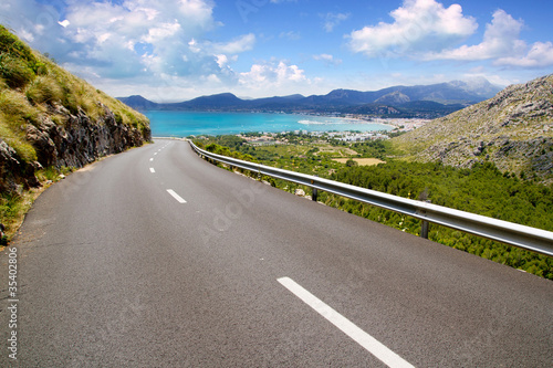 Leinwanddruck Bild curve of road in mountain with Pollensa view in Mallorca