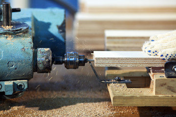Drilling a plywood at wood factory