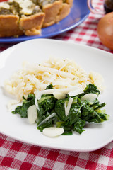 Silverbeet with noodles, garlic and grated cheese