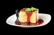 Baked rice pudding dessert with strawberry sauce and mint