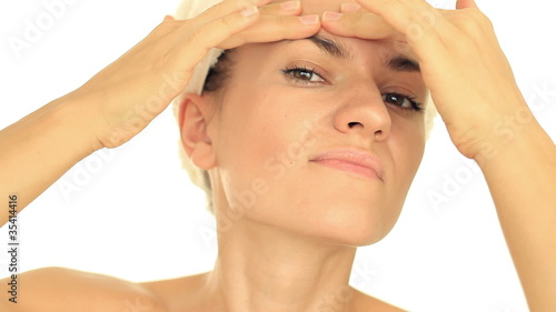 Young woman squeezing pimple, isolated on white