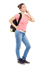 Female teenager talking on a mobile phone