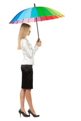 Full length, side view of business woman under umbrella