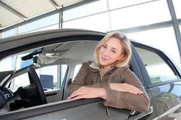Woman sitting in brand new car