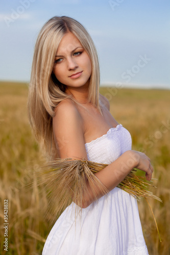 woman walking on wheat field