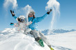 Winter, ski, snow and fun - happy skiers playing in snow