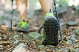 Fototapety Woman exercising in forest, nordic walking