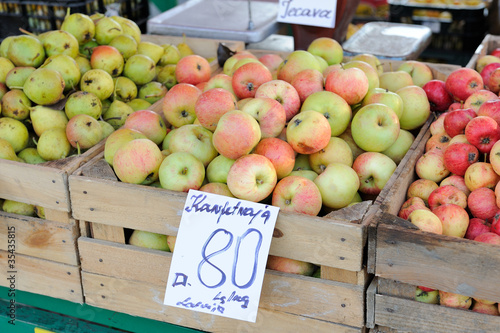 Ripe apples in box on a farm market