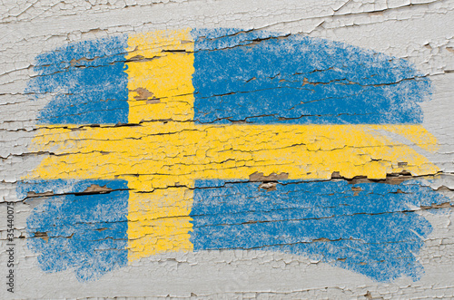 Fototapeta flag of Sweden on grunge wooden texture painted with chalk