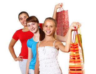 Pretty teenage girls with shopping bags