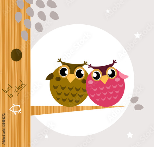 Two cute owl friends sitting on the branch.