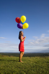 Woman in Red with Balloons