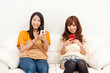 two asian women using smart phone