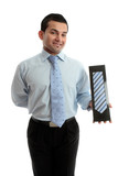 Smiling salesman proudly with a product merchandise poster