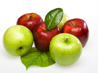 red and green wet apples on white background on the leaf