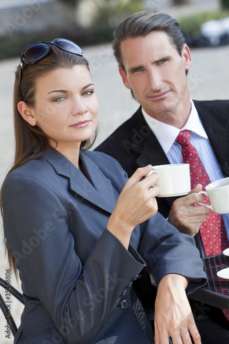 Beautiful Couple Man and Woman Having Drink At Cafe