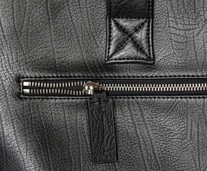 closeup zipper on black leather