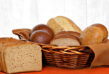 Full basket of healthy whole grain breads