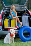 Girl with dog ready for the travel for summer vacation