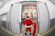 Santa Claus with empty sack doing wholesale shopping.