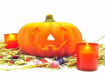 Calabaza de Halloween con velas y caramelos.