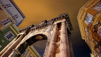 Night clouds and Roman arch