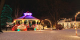 Small-town gazebo and depot lit up for Christmas