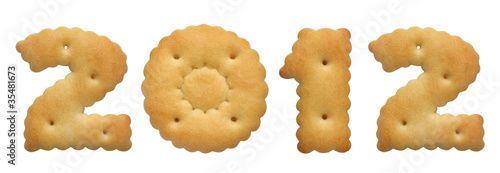 new year 2012. cracker in shape numeral on white background