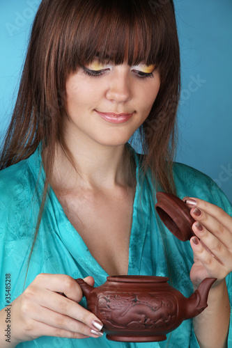 Tea ceremony with beautiful young woman
