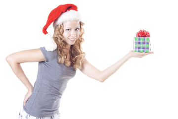 Pretty Santa girl with a present gift for New Year