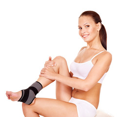 Woman with ankle brace.