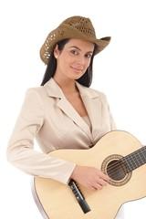 Portrait of beautiful female guitarist smiling