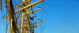 masts and details of sailing ship and blue sky