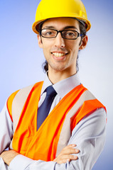 Young construction worker with hard hat