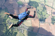 Skydiver in freefall high up in the air - 35491668
