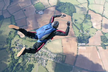 Skydiver in freefall high up in the air