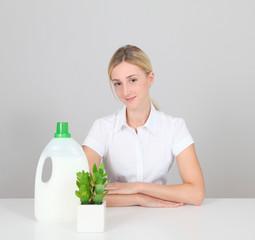 Woman presenting organic laundry detergent