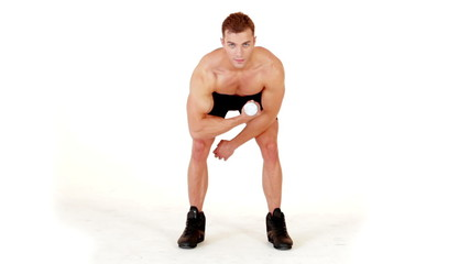 Muscular man exercising with dumbbells on white background