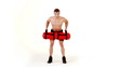 Handsome muscular man exercising with water bag on white