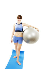 Fitness woman holding exercise pilates ball