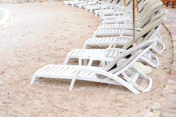 Chairs on white sand beach