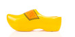 Dutch yellow wooden shoe over white background