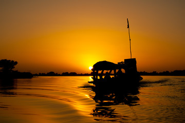 Pirogue at sunset, Mali (Africa).