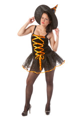 sexy girl in Halloween witch costume