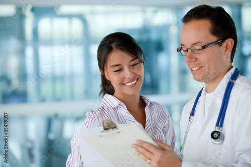 Insurance agent with a doctor