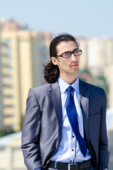 Young businessman at the street scene