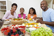 Leinwanddruck Bild - African American Parents Children Family Eating At Dining Table