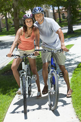 African American Woman & Man Couple Riding Bikes